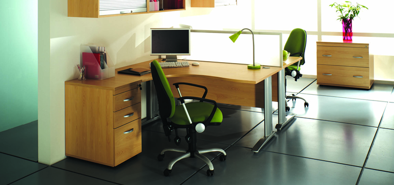 Radial desk with green office chairs