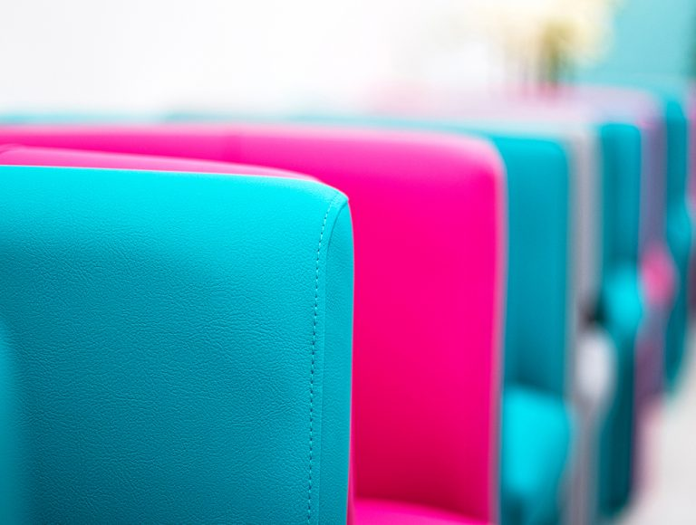 Close up of bright blue and magenta chairs