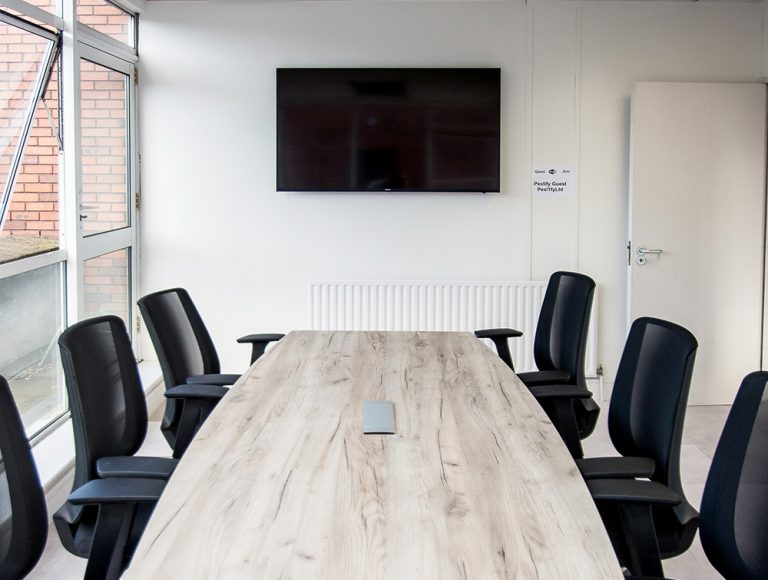 Plug socket accessory embedded in wood effect conference table