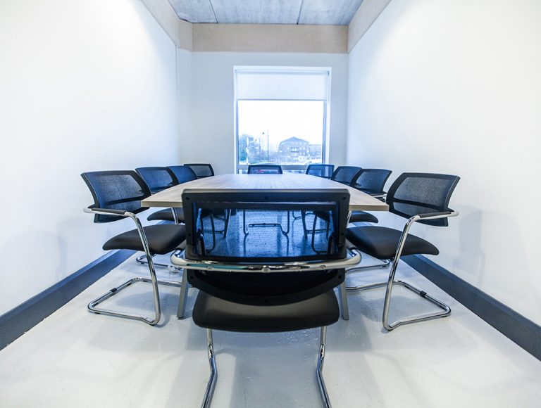 Confrence room with table and ten chairs