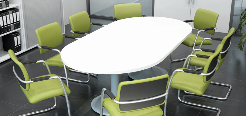 Office meeting room with whte and green table
