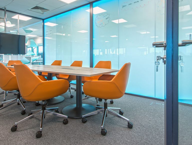 Orange chairs in conference room