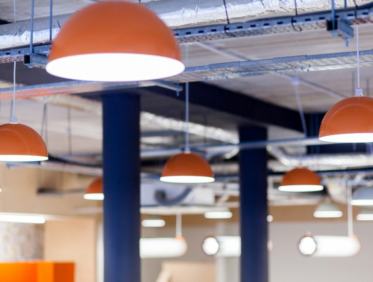 Orange light fittings with blue supports