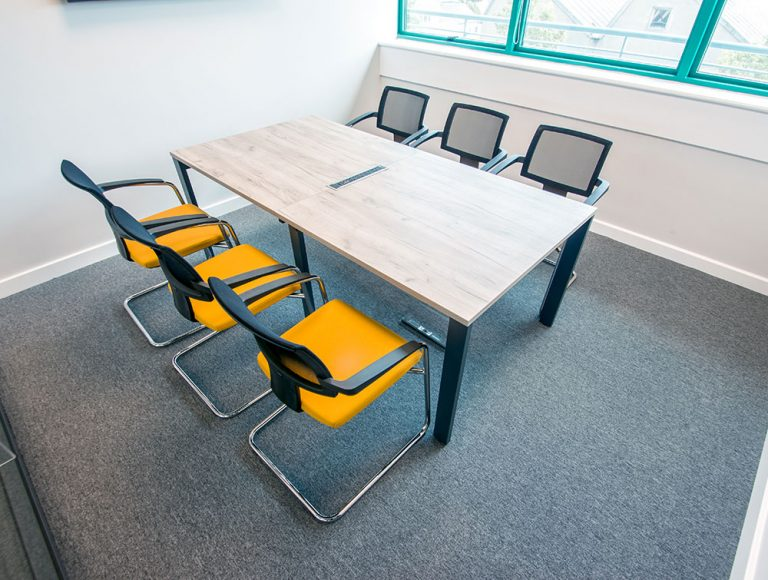 Six orange fabric seating chairs in a executive meeting rooms in Dublin
