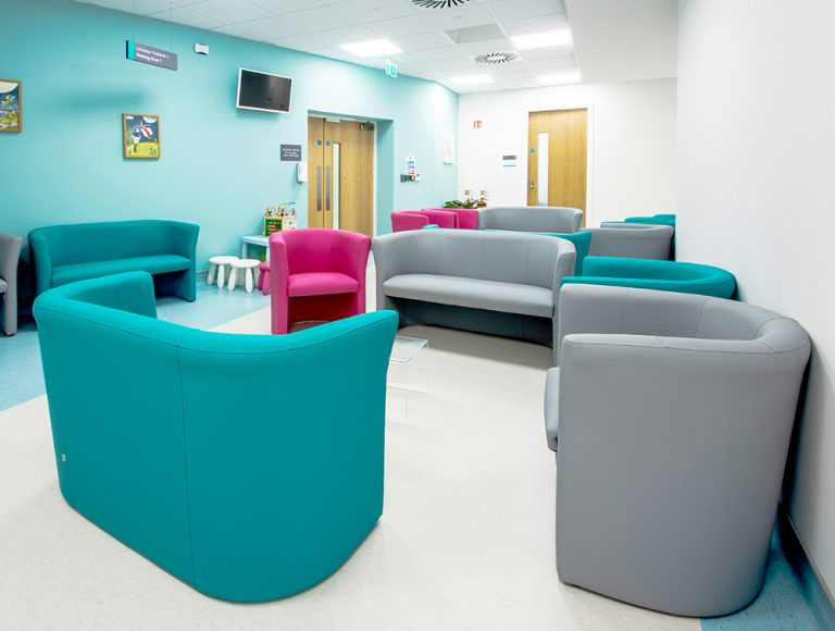 Break our area used for waiting room with comfy coloured sofas at Talacare location
