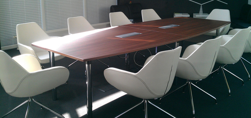modern conference room with switch socket for boat shape table