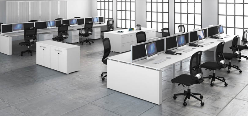 Bench desking system with white desks and black ergonomic chairs