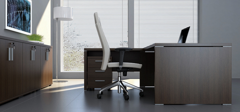 Executive office desks in wood with pedestal and full modesty panel