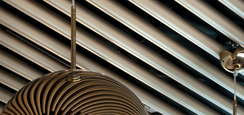 linear office ceiling in tubing metal
